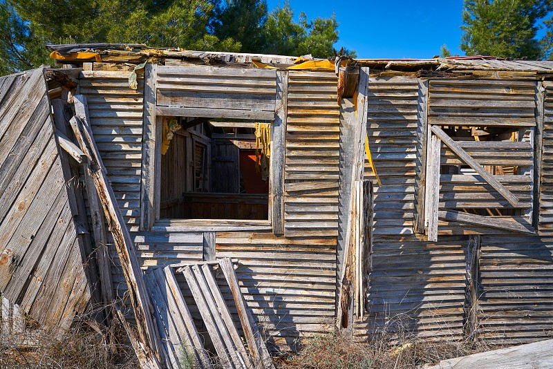 Old wooden cabin house destroyed by hurricane and abandoned photo