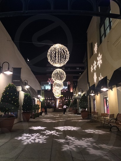 Round String Light Ball Decorations Hanging over Walkway photo