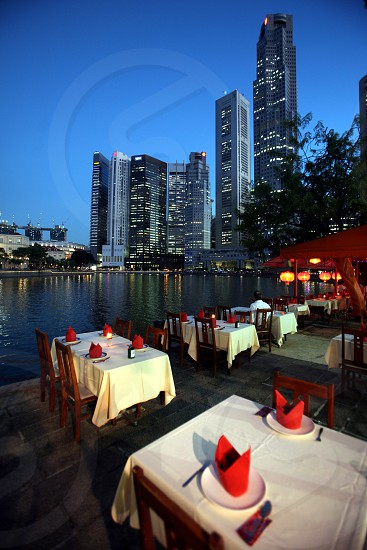 Restaurant at the boat quay at the Singapore River and Marina Bay in the city of Singapore in Southeastasia. photo