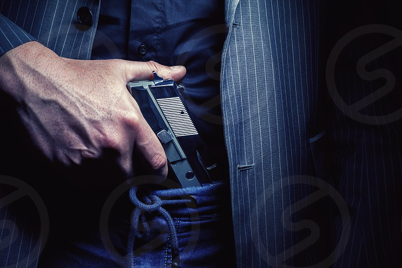 Details of a man with pistol conceptual composition about having a gun.  photo