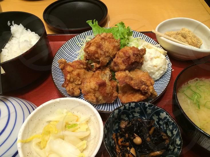 日本で普通によく食べられる定食です。唐揚げ・サラダ・副菜・お漬物・お味噌汁とご飯。日本の食風景です。 photo