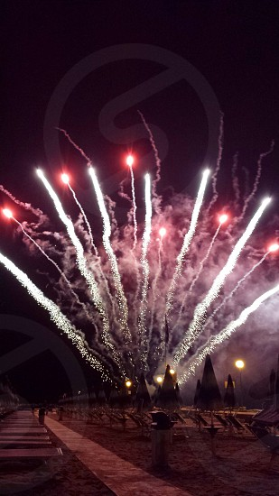 red and white timelaps photography of fireworks explosion photo