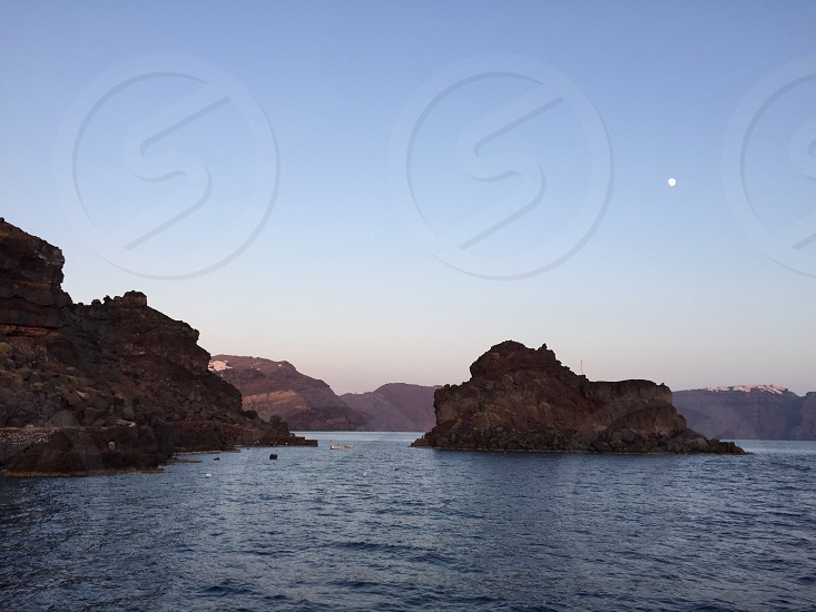 Santorini Greece Greek Islands travel islands nights cape moonsailing sunset.  photo
