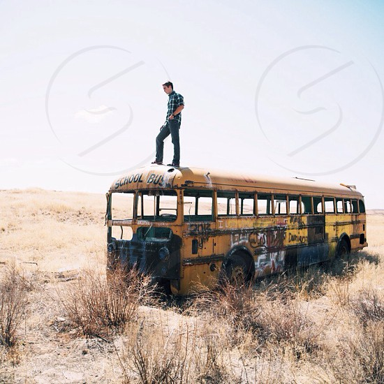 man on top of the bus photo