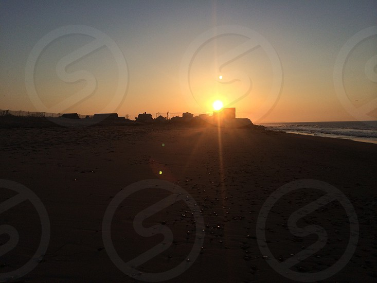 Sunrise May 2014. Misquamiquit Rhode Island. Private beach beach sunrise silhouette beauty summer seasons nature sand water ocean Atlantic Ocean rocks seashells photo