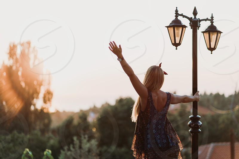 Young woman enjoying the view of the sunset photo