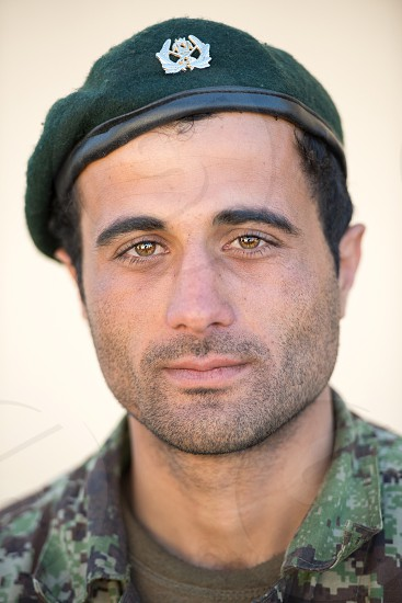 Afghan national army soldier war eyes sadness photo