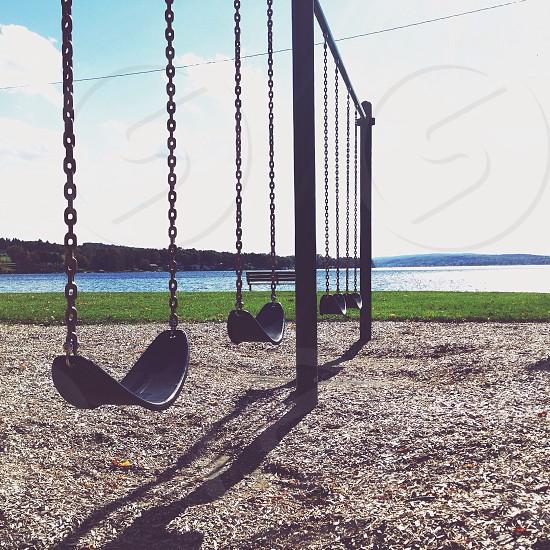 black metallic swings photo