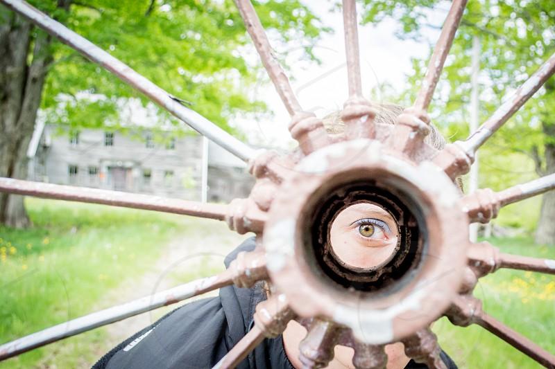 Eye peeking through the wheel center photo