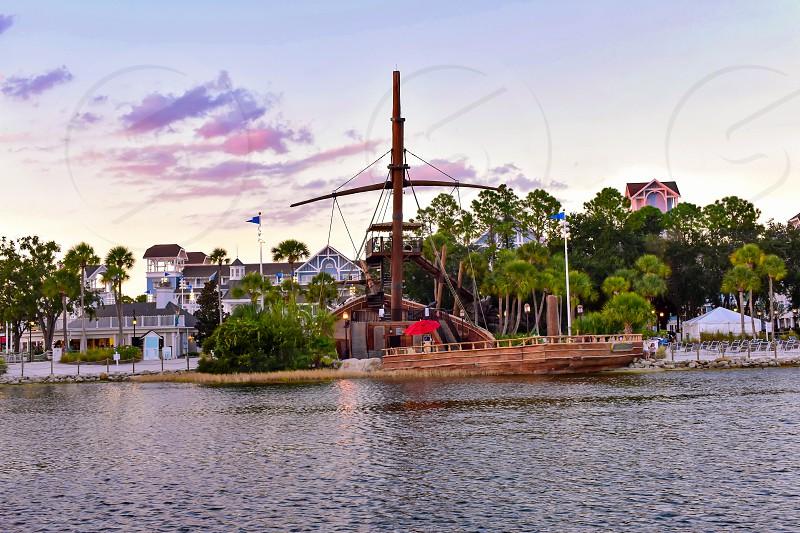 Orlando Florida. February 09 2019 Partial view of Pirate Ship and Village Hotel at Lake Buena Vista area (2) photo
