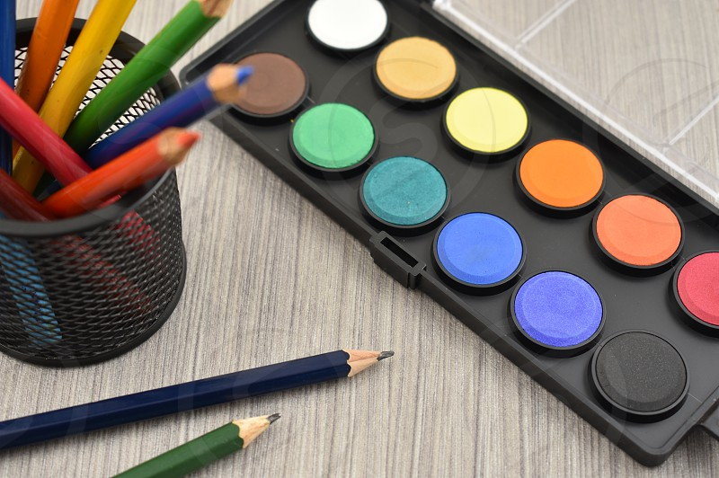Watercolor tool. Back to school. Art supplies on a wooden background. School supplies for painting photo