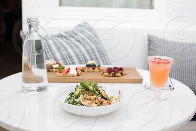 vegetable salad on white ceramic round bowl photo