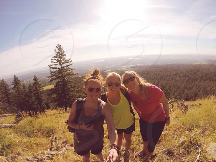 3 women in dark sunglasses photo