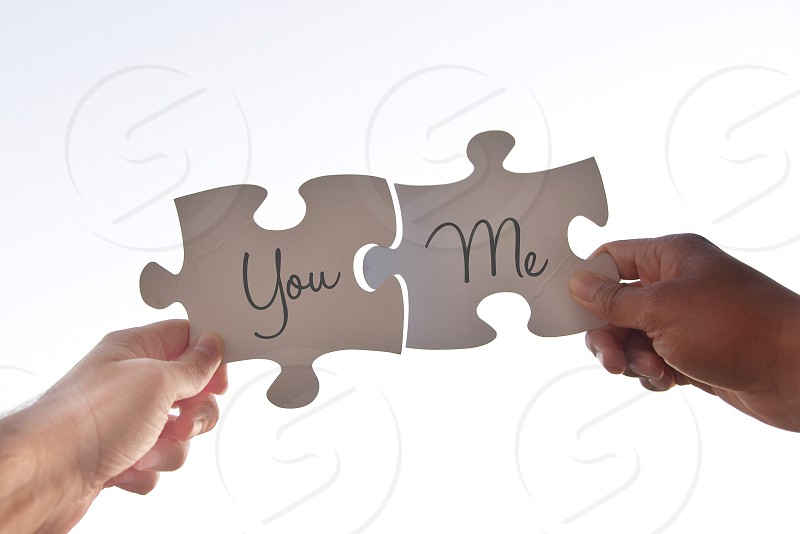 person holding white you and me print jigsaw puzzle photo