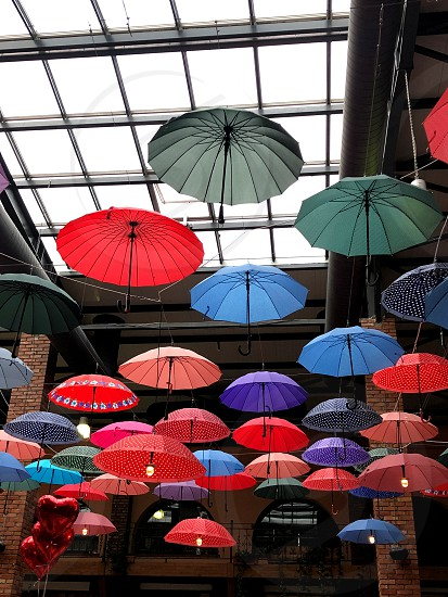 Beautiful colorful umbrellas hanging from the ceiling. Urban landscape. photo