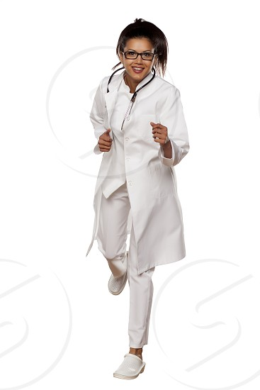 a young woman doctor in a panic run on a white background photo