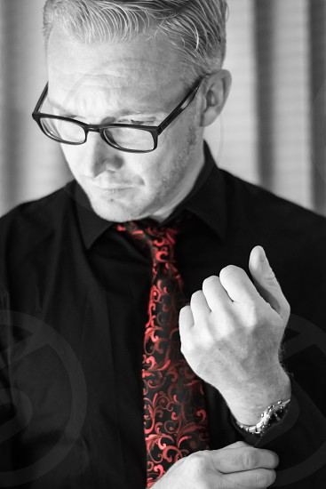 best dressed red tie black shirt and glasses ready for business photo