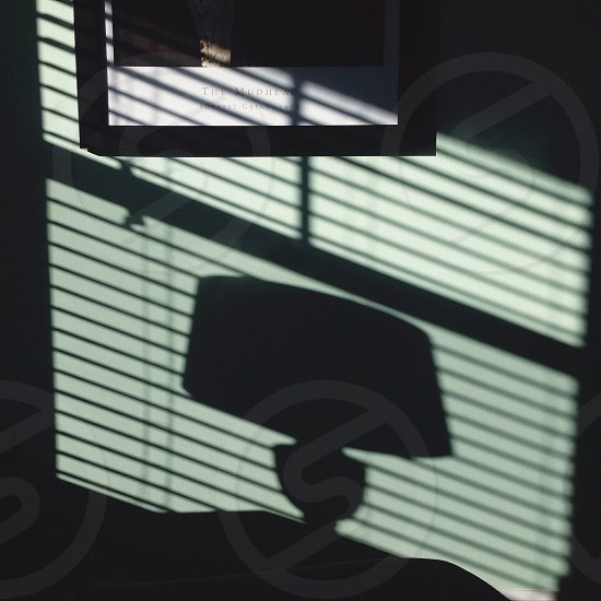 lampshade on table shadow photo