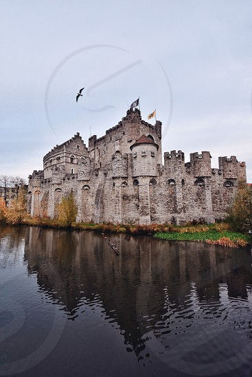 photo of stone castle with moat photo