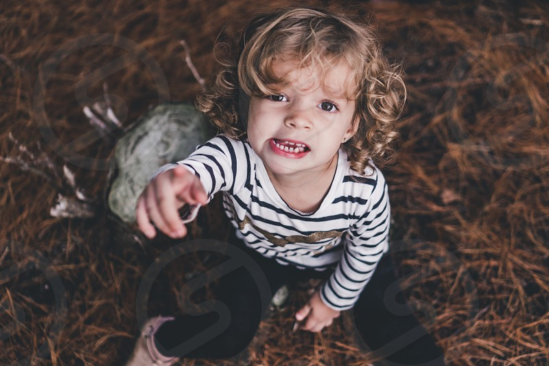 Messy-haired playful toddler girl  photo