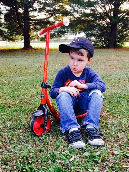 Child childhood play playtime scooter pout little boy  photo