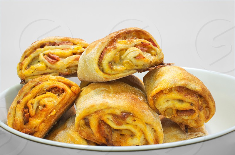 Homemade Pizza Rolls Food in White Bowl photo