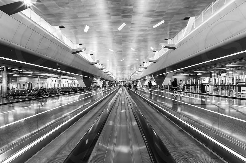 DOHA QATAR - JANUARY 23 2019: Moving walkways travellator in new Hamad International Airport photo