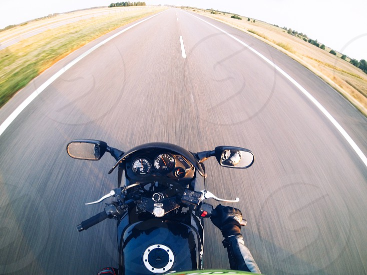 Motorcycle ride moto bike biker fast speed travel the way road street lovely point of view pov colors roadtrip two wheels photo