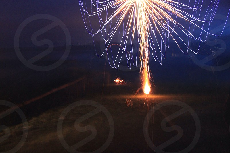 outdoor view of yellow fireworks photo