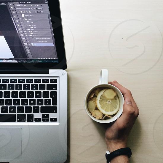 Mac book and ginger tea working.  photo