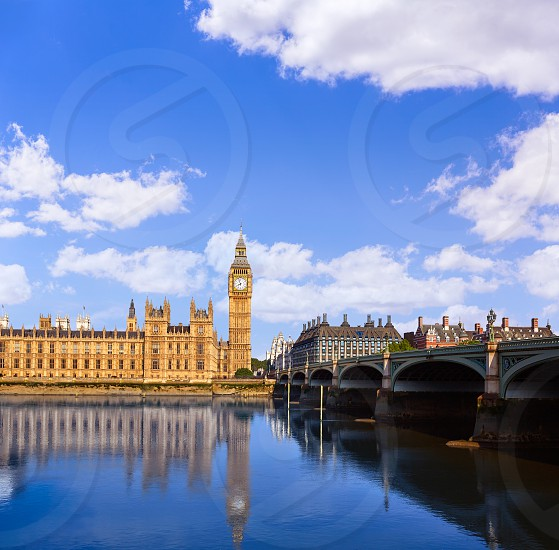 Big Ben Clock Tower and thames river in London at England photo