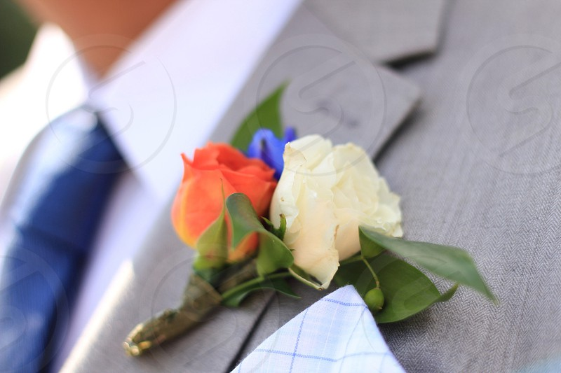 flowers pin on grey suit photo