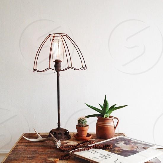 brown metal framed lamp photo