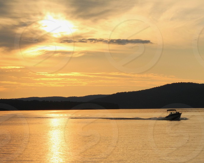 sunsets over water photo