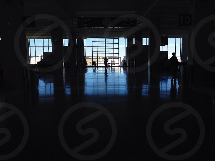 Dark airport terminal with windows photo