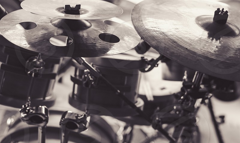 Closeup view of cymbals in black and white.   photo