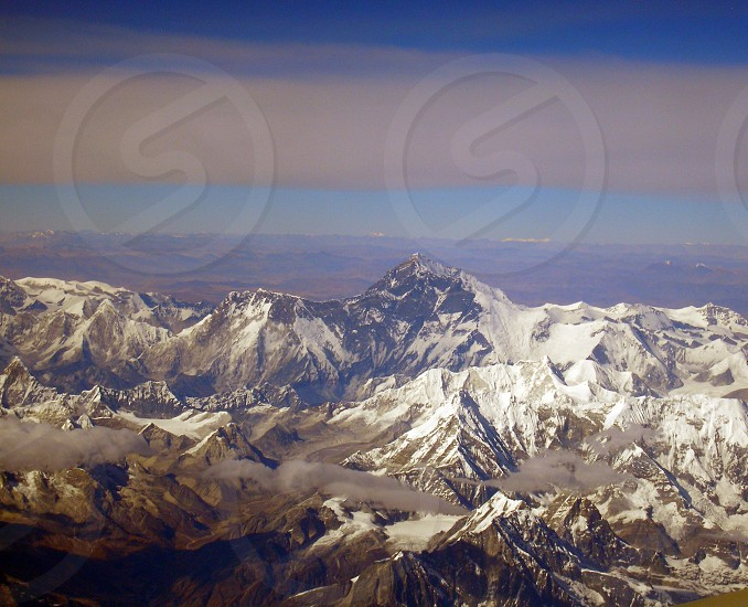 Aerial view of Mount Everest the world's highest mountain and the surrounding Himalaya.     photo