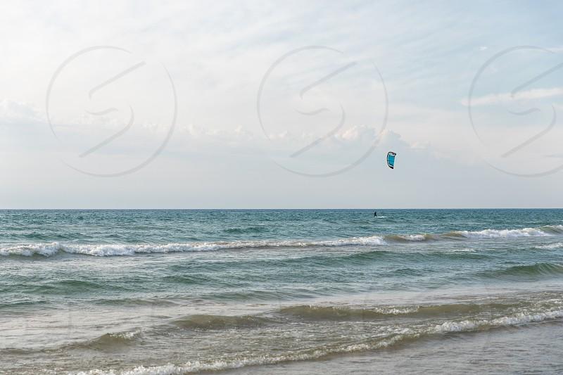 A kite surfer enjoying the waves at Suable Beach.  Bruce Peninsula Ontario Canada photo