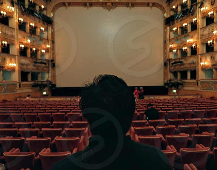 Guy standing in old cinema film theater photo