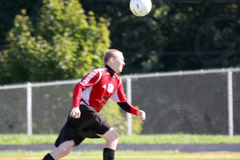 teen boy playing soccer photo