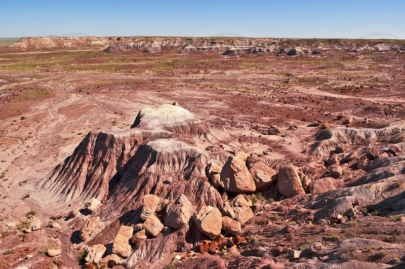 A view of the vast Painted Desert in Northern Arizona from the Blue Mesa in the Petrified National Forest. photo