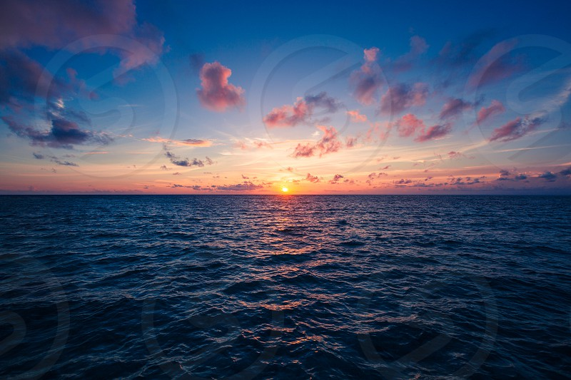 photo of sea during golden hour photo