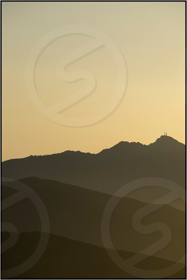 silhouette photography of mountain during golden hour photo