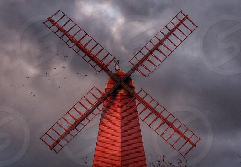 Windmill red dusk evening sunset mill sails Brighton  photo
