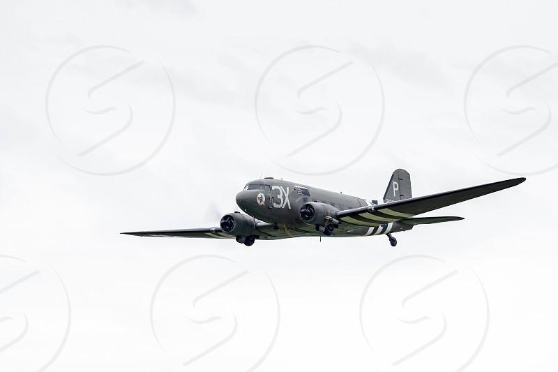 "Douglas C-47A Skytrain ""Drag 'em oot"" N473DC flying over Shoreham Airfield photo"