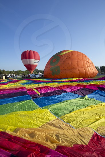red and white hot air balloon photo