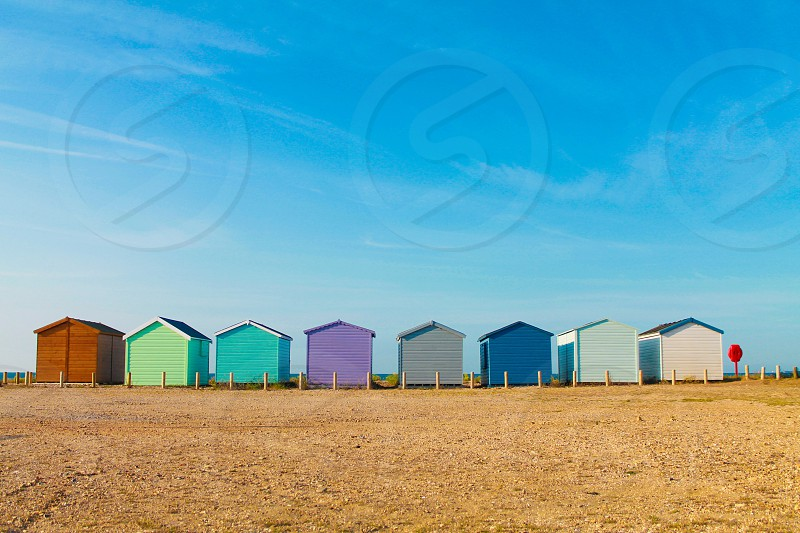Unity togetherness. Strength beach huts uniqueness  photo