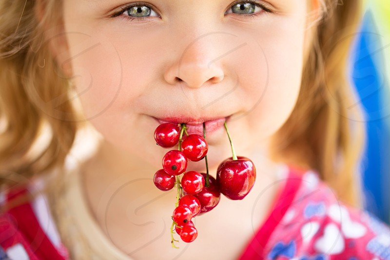 Cute girl with tasty vitamins summer joy happy amazing strawberries cherry food photo