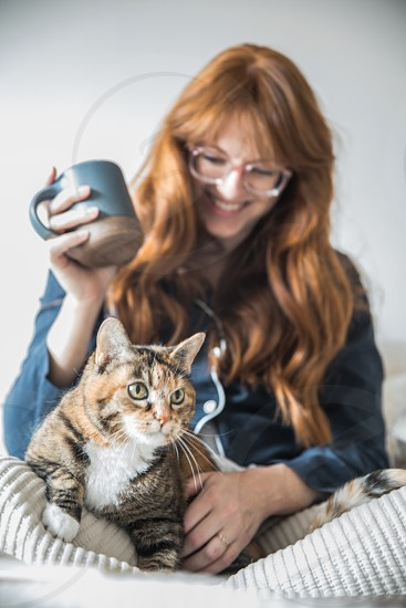 A woman in bed with a cat.  photo