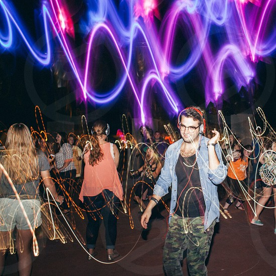 crowd dancing with laser lights photo